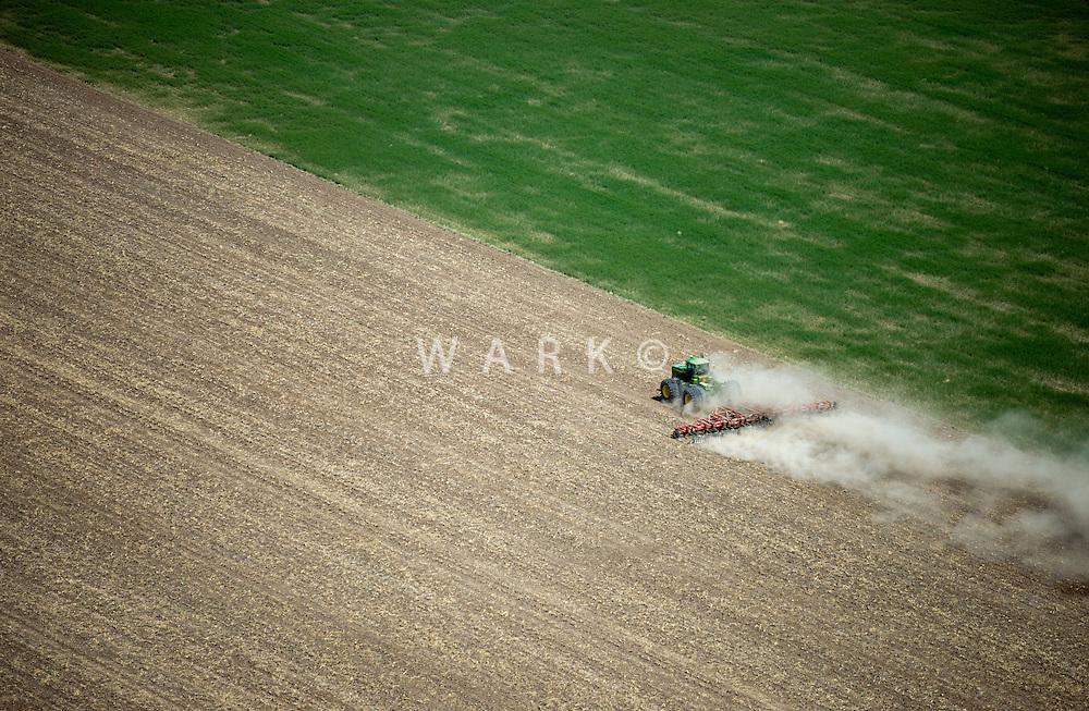 Colorado farmer plowing with tractor, eastern Colorado plains. May 2014. 83923