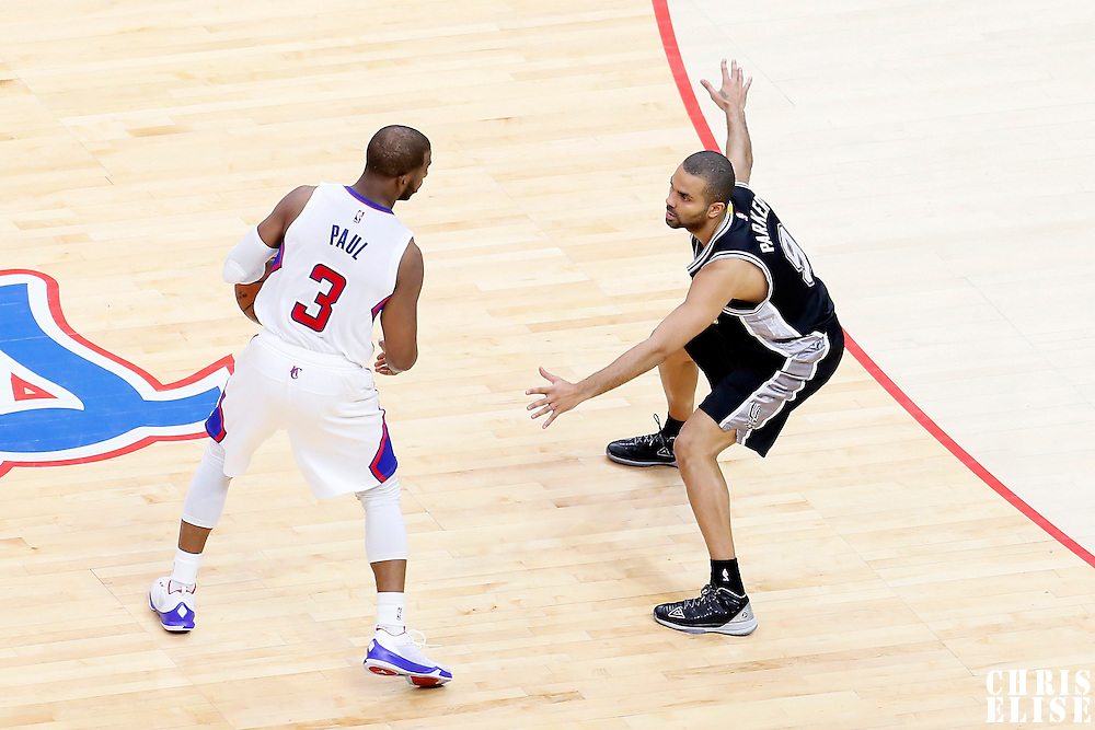 19 April 2014: San Antonio Spurs guard Tony Parker (9) defends on Los Angeles Clippers guard Chris Paul (3) during the Los Angeles Clippers 107-92 victory over the San Antonio Spurs, during Game One of the Western Conference Quarterfinals of the NBA Playoffs, at the Staples Center, Los Angeles, California, USA.