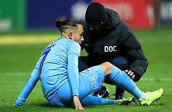 Coventry City's Jodi Jones receives medical treatment on the pitch before coming off injured