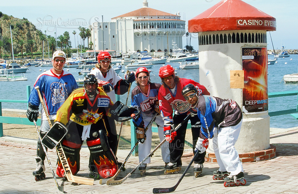 3 October 1998: Outdoor roller hockey in-line skating rink on Catalina Island, Catalina, Los Angeles County California. Group of pro and semi-pro hockey players posing by the Casino and beach.