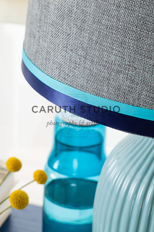 One Dresser Three Ways: Ribbon bands in navy and aqua on lampshade