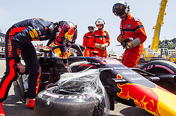 May 26, 2018 - Monte Carlo, Monaco - MAX VERSTAPPEN of Netherlands checks out the suspension damage to his Red Bull Racing-TAG Heuer RB14 after crashing during morning practice for the Formula One Grand Prix de Monaco. The damage done also required a gearbox change, and repairs were not completed in time for Verstappen to set a time during Saturday's qualifying session. (Credit Image: © Robert Szaniszlo/NurPhoto via ZUMA Press)