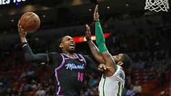 January 11, 2019 - Miami, FL, USA - El jugador del Heat James Johnson (16) avanza al aro ante la defensa de Kyrie Irving (11), de los Celtics, en el primer cuarto del partido celebrado el 10 de enero de 2019 en Miami. (Credit Image: © David Santiago/Miami Herald/TNS via ZUMA Wire)