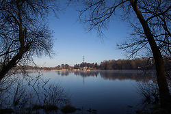Harefield, UK. 19 January, 2020. A view across a lake in Colne Valley Regional Park across which a 3.4 km-long viaduct would be constructed should plans for the HS2 high-speed rail link be approved.