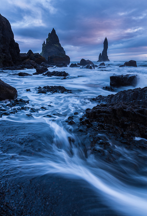 incoming waves create foreground interest in this coastal landscape at sunset near Vik, Iceland