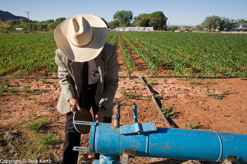 "June 16, 2008 -- COLORADO CITY, AZ: JOSEPH JESSOP, 86 years old, works on a water filter that irrigates the community corn field in Colorado City, AZ. Jessop, a polygamist and member of the FLDS, was arrested during the Short Creek Raid in 1953 and had his wives and children taken from him for two years. Colorado City and neighboring town of Hildale, UT, are home to the Fundamentalist Church of Jesus Christ of Latter Day Saints (FLDS) which split from the mainstream Church of Jesus Christ of Latter Day Saints (Mormons) after the Mormons banned plural marriage (polygamy) in 1890 so that Utah could gain statehood into the United States. The FLDS Prophet (leader), Warren Jeffs, has been convicted in Utah of ""rape as an accomplice"" for arranging the marriage of teenage girl to her cousin and is currently on trial for similar, those less serious, charges in Arizona. After Texas child protection authorities raided the Yearning for Zion Ranch, (the FLDS compound in Eldorado, TX) many members of the FLDS community in Colorado City/Hildale fear either Arizona or Utah authorities could raid their homes in the same way. Older members of the community still remember the Short Creek Raid of 1953 when Arizona authorities using National Guard troops, raided the community, arresting the men and placing women and children in ""protective"" custody. After two years in foster care, the women and children returned to their homes. After the raid, the FLDS Church eliminated any connection to the ""Short Creek raid"" by renaming their town Colorado City in Arizona and Hildale in Utah.  Photo by Jack Kurtz / ZUMA Press"