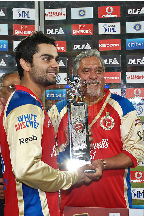 Virat Koholi recives the Man of the Match trophy from Vijay Mallya(R) during match 35 of the the Indian Premier League ( IPL ) Season 4 between the Royal Challengers Bangalore and the Pune Warriors held at the Chinnaswamy Stadium, Bangalore, Karnataka, India on the 29th April 2011..Photo by Saikat Das/BCCI/SPORTZPICS