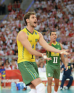 LODZ, POLAND - SEPTEMBER 16: Bruno Mossa Rezende  of Brazil celebrates after winning a point during the FIVB World Championships match between Poland and Brazil on September 16, 2014 in Lodz, Poland. (Photo by Piotr Hawalej)
