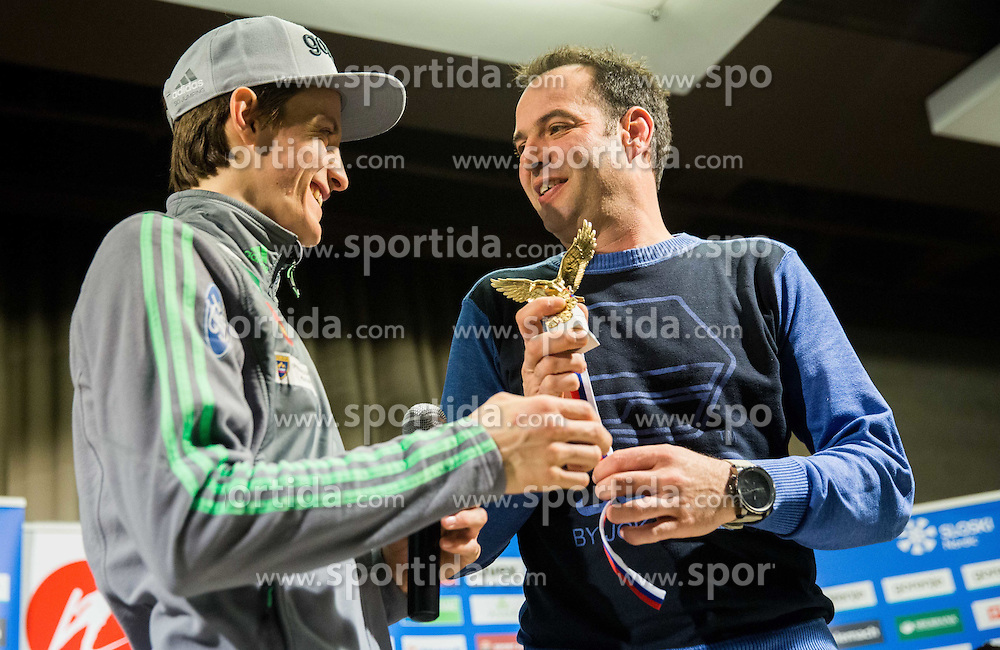 Peter Prevc with and a replica of Four Hills Tournament trophy Eagle for Tomaz Verdnik during press conference of Slovenian Ski jumping team after World Cup competitions in Vikersund, on February 16, 2016 in Maximarket, Ljubljana, Slovenia. Photo by Vid Ponikvar / Sportida