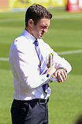 Shrewsbury Town manager Sam Ricketts looking at his watch during the EFL Sky Bet League 1 match between AFC Wimbledon and Shrewsbury Town at the Cherry Red Records Stadium, Kingston, England on 14 September 2019.