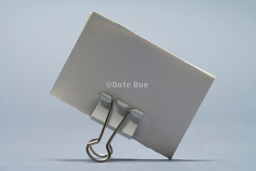 piece of blank paper hold with a clip