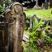 Headstones at the cemetery at St. Tanwg's Church in Harlech on Wales's northwestern coast, in Snowdonia.