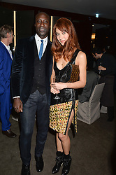 OZWALD BOATENG and OLGA KURYLENKO at a dinner hosted by Liberatum to honour Francis Ford Coppola held at the Bulgari Hotel & Residences, 171 Knightsbridge, London on 17th November 2014.