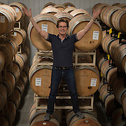 Kyle MacLachlan pouring his Pursued by Bear wine at Dunham spring release wekend 2015