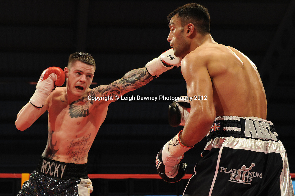 Adil Anwar defeats Dave Ryan (left) in a 10x3 Light Welterweight contest at the Aintree Equestrian Centre, Liverpool on the 19th May 2012. Frank Maloney Promotions © Leigh Dawney Photography 2012.