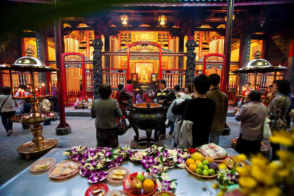 Worshipers perform religious rituals at Longshan Temple in Taipei, Taiwan.