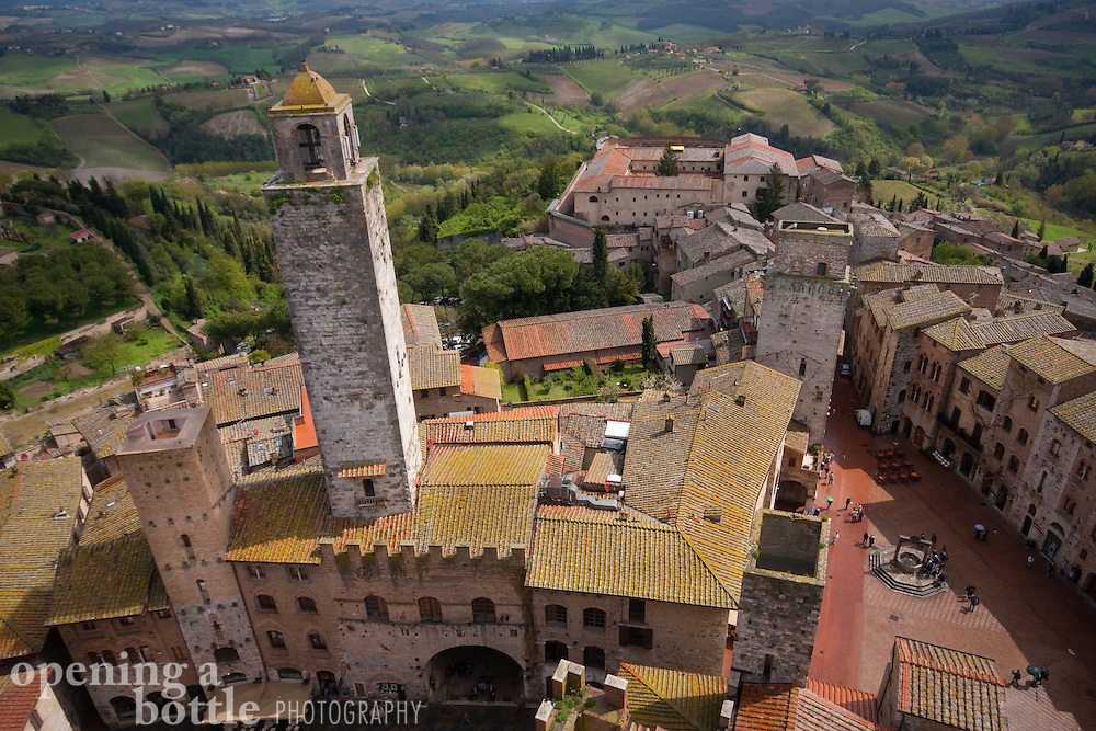 San Gimignano's towers as seen from above, with the Tuscan countryside in the distance, Tuscany, Italy.