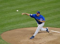 Phoenix, AZ-04-26-04 Chicago Cubs pitcher Carlos Zambrano throws a pitch in a 9-0 loss to the Arizona Diamondbacks. Zambrano pitched 4 1/3 innings and had a base hit. Ross Mason photo