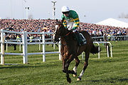 Anibale Fly and jockey Barry Geraghty head to the start for the 5:15pm The Randox Health Grand National Steeple Chase (Grade 3) 4m 2f during the Grand National Meeting at Aintree, Liverpool, United Kingdom on 6 April 2019.