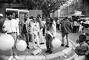 Man blowing up balloons, Notting Hill Carnival, London, 1989
