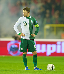 BRUSSELS, BELGIUM - Tuesday, October 15, 2013: Wales' captain Aaron Ramsey looks dejected as Belgium score the opening goal during the 2014 FIFA World Cup Brazil Qualifying Group A match at the Koning Boudewijnstadion. (Pic by David Rawcliffe/Propaganda)