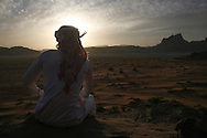 A Bedouin man gaze at the sunset in Wadi Rum Jordan, may 14, 2013. Photo by Oren Nahshon