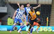 Hull City midfielder Mohammed Diame (17) fends off Brighton central defender, Connor Goldson (17) during the Sky Bet Championship match between Hull City and Brighton and Hove Albion at the KC Stadium, Kingston upon Hull, England on 16 February 2016.