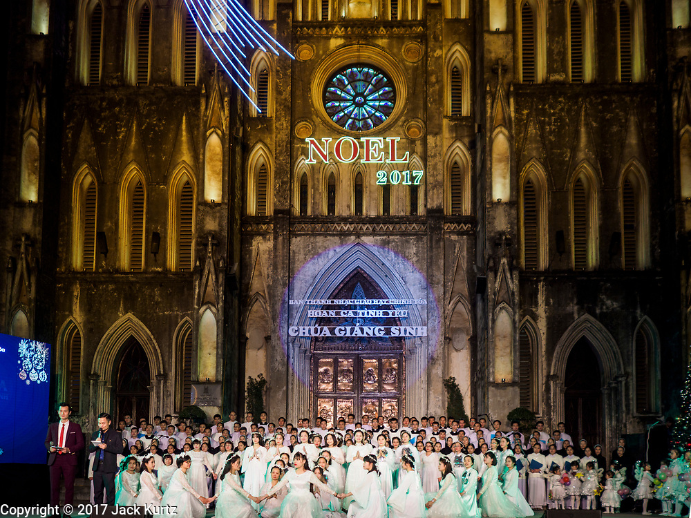 22 DECEMBER 2017 - HANOI, VIETNAM: Christmas carolers perform during the Christmas show at St. Joseph's Cathedral in Hanoi. There are about 5.6 million Catholics in Vietnam. The Cathedral was one of the first structures built by the French during the colonial era and was opened in 1886. It's one of the most popular tourist attractions in Hanoi.    PHOTO BY JACK KURTZ
