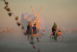 Apr 28, 2016 - Tankwa Town, Karoo Desert, South Africa - People walk and ride by one of AfrikaBurn's ''mutant vehicles'' shaped like a snail during the annual event of AfrikaBurn in the Karoo Desert, South Africa, on April 28, 2016. AfrikaBurn, the smaller cousin of Burning Man, is now in its tenth year and aims to bring together creatives from all around the world to create art, exist in a non-monetary economy, and celebrate an alternative form of living. (Credit Image: © Tobin Jones/ZUMA Wire/ZUMAPRESS.com)