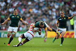 Jean De Villiers of South Africa is tackled - Mandatory byline: Patrick Khachfe/JMP - 07966 386802 - 19/09/2015 - RUGBY UNION - Brighton Community Stadium - Brighton, England - South Africa v Japan - Rugby World Cup 2015 Pool B.