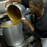 Volunteers preparing food for Thanksgiving for the homeless a week in advance. <br />