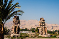 The Colossi of Memnon are two massive stone statues of Pharaoh Amenhotep III. Close to Luxor, Egypt.