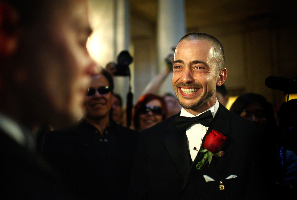 With eyes filled with tears, Joe Alfano, 37, looks across to his domestic partner, Frank Capley, 33, during their wedding ceremony, at City Hall, in San Francisco, CA, on Tuesday, June 17, 2008. The couple have been together for 8 years. They first married in 2004.