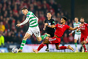 Shaleum Logan (#2) of Aberdeen lunges in late with a challenge on Callum McGregor (#42) of Celtic during the Betfred Cup Final between Celtic and Aberdeen at Celtic Park, Glasgow, Scotland on 2 December 2018.