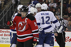 Mar 29; Newark, NJ, USA; Tampa Bay Lightning left wing Ryan Malone (12) celebrates his 3rd goal of the game during the second period of their game against the New Jersey Devils at the Prudential Center.