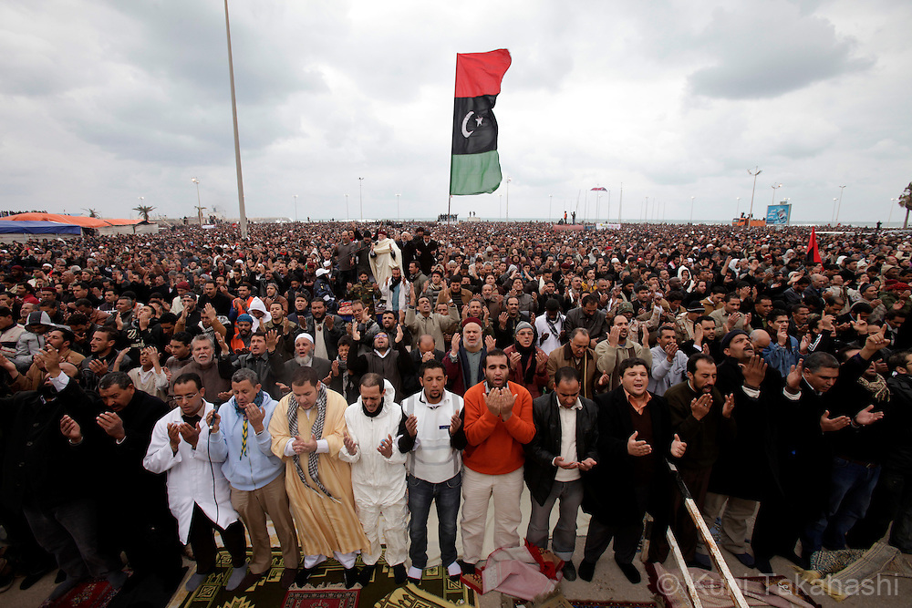 Protesters against Col. Muammar Gaddafi pray during prayer service in Benghazi, Libya, on Feb 25, 2011. The oppositions against Gaddafi took control of the city earlier this week. .Photo by Kuni Takahashi