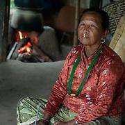 Nepal 2014. Arun valley. Pangma village. Damanta Devi drinking millet beer.