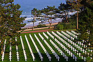 Graves of the fallen are seen with Omaha Beach in the background at the Normandy American Cemetery and Memorial, on September 27, 2013, at Colleville-sur-Mer, France. (Photo by Warrick Page - American Battle Monuments Commission)