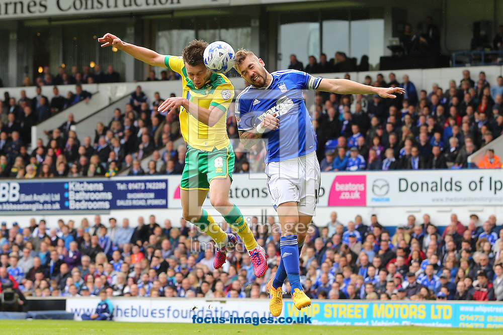 Jonathan Howson of Norwich City and Luke Chambers of Ipswich Town during the Sky Bet Championship play off semi final first leg at Portman Road, Ipswich<br /> Picture by Richard Calver/Focus Images Ltd +44 7792 981244<br /> 09/05/2015