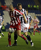 Photo: Mark Stephenson.<br /> West Bromwich Albion v Stoke City. Coca Cola Championship. 03/10/2007.Stoke's Carl  Dickinson holds the ball up from West Brom's Chris Brunt