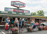 The ice cream counter at Sawyer's Dairy Bar sees a brisk business in Thursday heat.  (Karen Bobotas/for the Laconia Daily Sun)