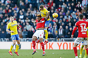 Leeds United defender Liam Cooper (6) beats Middlesbrough forward Britt Assombalonga (9) in the air during the EFL Sky Bet Championship match between Middlesbrough and Leeds United at the Riverside Stadium, Middlesbrough, England on 9 February 2019.