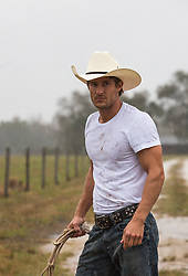 All American Cowboy on a ranch in the rain