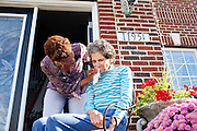 """Karen Morris has been caring for her mother Gloria, 80, for the past 10 years. Her mother has Alzheimer's disease and lives with Karen and Karen's husband Richard in their Charlotte, NC home. She wipes her mother's face as the pair sit on the front porch in the sun...Mrs. Morris was a nurse before she retired and really enjoys taking care of people, she said. Every morning she washes her mother in the bathroom, helps her walk down the stairs, and they share breakfast, as they did Monday, October 18, 2010...Gloria was having an especially bad day and because Karen sees her every day, she knew something was wrong. She later discovered her medication was dehydrating her. That is one of many reasons why having a regular caretaker is so important. ..Released: Yes.""""Caretaker"""".Assignment c/o Ilene Bellovin"""