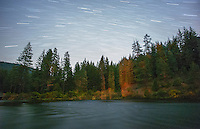 Star Trails over the Metolius River, with tree shadows thrown by campfire light.<br /> <br /> Shot in Oregon, USA