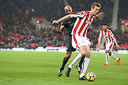Peter Crouch shields the ball from Vincent Kompany during the Premier League match between Stoke City and Manchester City at the Bet365 Stadium, Stoke-on-Trent, England on 12 March 2018. Picture by Graham Holt.