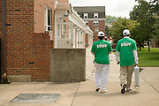 Ohio University's President Roderick McDavis and First Lady Deborah McDavis help a first year student move into their residence hall.  Photo by Ben Siegel