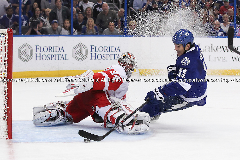 16 April 2015: Tampa Bay Lightning center Brian Boyle (11) takes a shot well falling into Detroit Red Wings goalie Petr Mrazek (34) that ended up in the back of the net for a goal in the 1st period of Game 1 of the First Round of the Stanley Cup Playoffs between the Detroit Red Wings and Tampa Bay Lightning at Amalie Arena in Tampa, FL.