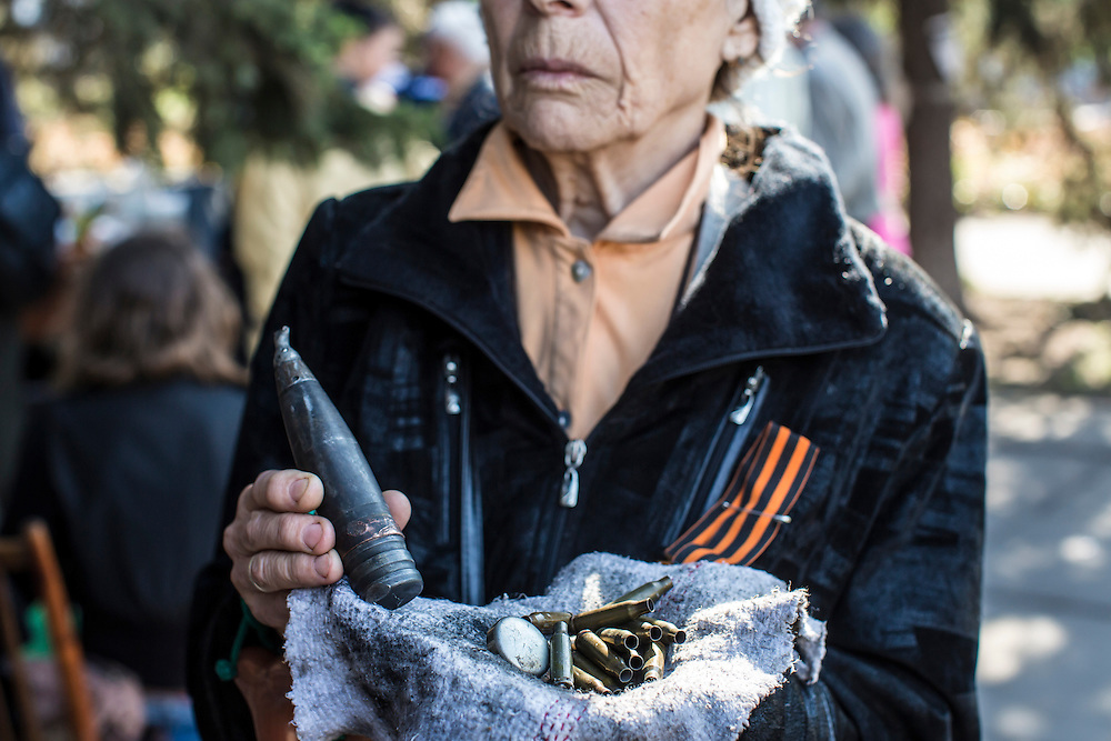 MARIUPOL, UKRAINE - MAY 11: A woman shows munitions reportedly used by the Ukrainian military against pro-Russian activists in recent clashes on May 11, 2014 in Mariupol, Ukraine. A referendum on greater autonomy is being held after pro-Russian activists took over at least ten cities in the eastern part of the country. (Photo by Brendan Hoffman/Getty Images) *** Local Caption ***