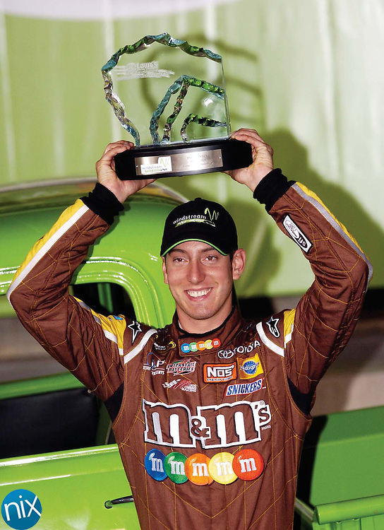 Kyle Busch celebrates after finishing first in the pole during qualifying for the Coca-Cola 600 Thursday night at Lowe's Motor Speedway.
